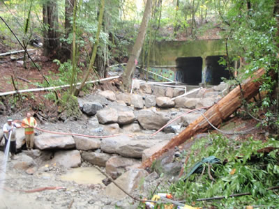 Finishing installation of rock weirs to assist fish passage through underpass on Dutch Bill Creek